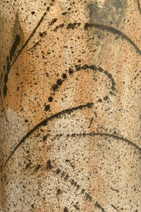 Close up of Kanji lidded vessel showing brush and glaze patterns